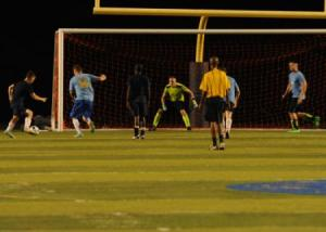 Sailors and Marines from USS AMERICA meet their counterparts from the US Navy Base at Guantanamo Bay in a friendly match.