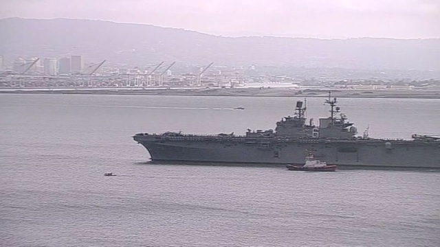 USS AMERICA (LHA 6) Under Way to Her Home Port in San Diego. Port of Oakland in Background