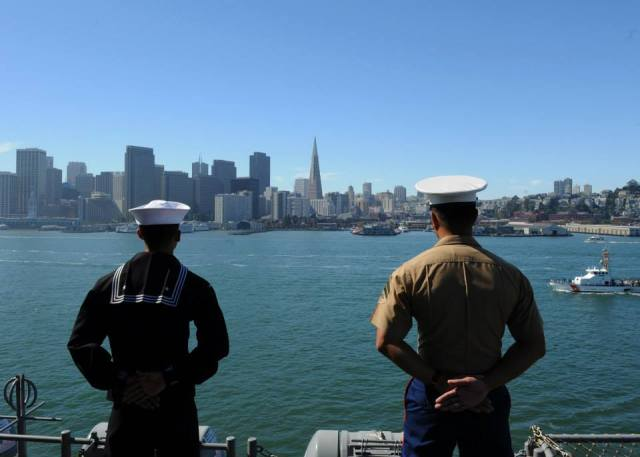 Sailors and Marines View the San Francisco Skyline as They Man the Rails for Her Arrival